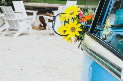 Volkswagon Van decorated with daisies at Little Point Clear Venue in Fairhope, AL photographed by Jenni Guerry Photography